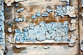 pic of nail paint  - stripped paint in the blue wood door and rusty nail - JPG