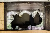 foto of abandoned house  - A broken window - JPG