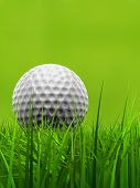image of competition  - Green fresh natural 3d conceptual grass field on blur background with a golf ball at horizon metaphor to club - JPG