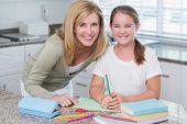 pic of homework  - Happy mother helping daughter doing homework - JPG