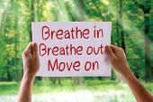 stock photo of breathing exercise  - Breathe In Breathe Out Move On card with nature background - JPG