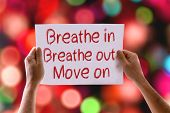 stock photo of breathing exercise  - Breathe In Breathe Out Move On card with colorful background with defocused lights - JPG