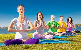 foto of yoga  - Group of young people have meditation on yoga class - JPG