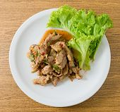 picture of thai cuisine  - Thai Cuisine and Food Top View of Thai Traditional Nam Tok or Spicy Beef Salad Served with Lettuce Leaves - JPG