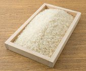 pic of thai cuisine  - Cuisine and Food Uncooked White Long Rice Basmati Rice or Thai Jasmine Rice in A Wooden Tray - JPG
