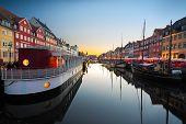 Ships in Nyhavn at sunset, Copenhagen, Denmark poster