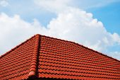 picture of red roof tile  - Grunge red roof with cloudy blue sky - JPG
