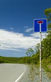 picture of rear-end  - Road dead end sign in front of a real dead end - JPG