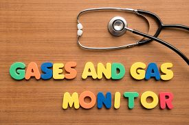 stock photo of gases  - Gases and Gas monitor colorful word with stethoscope on the wooden background - JPG
