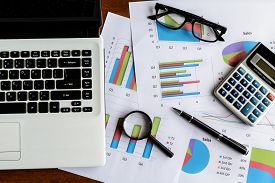picture of analysis  - Laptop on Desk office and Graph analysis spreadsheet Business finance - JPG