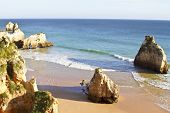 Rocks and ocean at Praia Tres Irmaos in Alvor Portugal