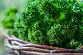 Kale In Rustic Basket On Daylight  Close Up poster