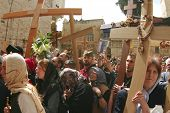 JERUSALEM - APRIL 21: Pilgrims come to Holy Sepulchre for pray, after a Crucession, in front of Temple, on Good Friday April 21, 2006 in Jerusalem, Israel.