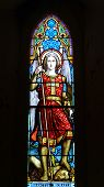 Nineteenth century church window Saint Michael defeating Satan
