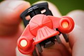 Red Toy Train Held By Child In Fingers