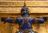 stock photo of glorify  - Monkey carry golden pagoda decoration in temple of emerald Buddha - JPG