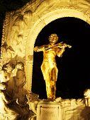 Golden statue of Johann Strauss