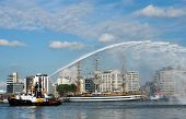 Demonstrations by the river fire brigade on the river Scheldt in the city of Antwerp, on the occasion of the 50th Tall Ships Race in 2006