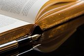 Pen and ancient poetry book