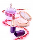Lipstick, powder and perfume isolated on white