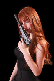 image of girls guns  - Attractive red girl with gun on black background - JPG
