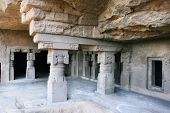 stock photo of ellora  - Inside of ancient Ellora rock carved Buddhist temple - JPG