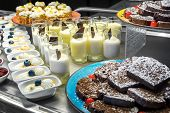 Selection Of Desserts At A Dessert And Cake Buffet, Served On Stainless Steel Tables poster