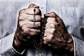 African American male hands praying holding a beads rosary with Jesus Christ in the cross or Crucifi poster