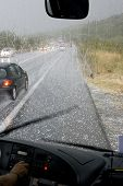 picture of hail  - driving in a dangerous road during a hail storm in Greece - JPG
