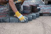 stock photo of bricklayer  - Pavers hands - JPG