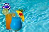 Blue Hawaiian and Mai Tai cocktails on swimming pool side