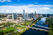 High Above City Downtown Austin Skyline Cityscape From Butler Park Green Space Pond Water Symmetry S poster