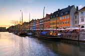 Scenic Evening Panorama Of Famous Nyhavn Pier Architecture In The Old Town Of Copenhagen, Denmark poster