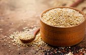 Quinoa White grains in a wooden bowl and spoon. Gluten free Healthy food. Diett, dieting concept. Se poster