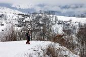Woman tourist in Transilvanian village