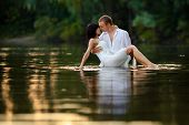 A Beautiful Young Couple In The Water