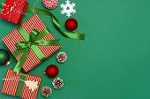 Gift Boxes, Christmas Balls, Toys, Fir Cones, Ribbon On Green Background. Festive, Congratulation, N poster