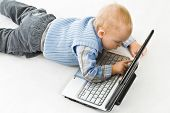 Concept of little businessman. Little child and laptop