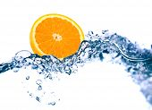 Orange in a water on a white background