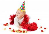 a baby is sitting on a floor with christmas decoration. isolated on a white background
