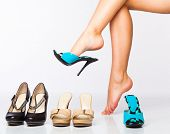 stock photo of stiletto  - female legs in fashion shoes - JPG