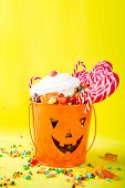 Halloween Sweets Concept, Bucket In The Form Of A Festive Pumpkin, Full Of Sweets And Candies, Cooki poster