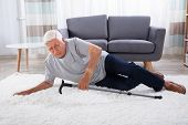 Senior Man Fallen On Carpet With Walking Stick poster