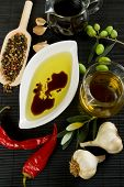 Olive oil and balsamic vinegar with spices and food ingredients