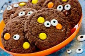 Halloween Cookies, Homemade Chocolate Cookies With Candy Eyes And Chocolate Orange And Yellow Candy, poster