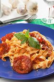 Italian milanese pasta with tomato sauce and fresh basil