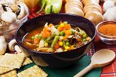 Minestrone vegetable soup with carrot, green peas and corn