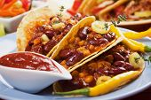 Chili con carne burritos in corn taco shells