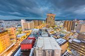 Kanazawa, Japan downtown rooftop cityscape at dusk. poster