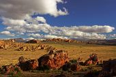 Landscape - Desert Yellow- Red Desert Rocks Under Blue Sky With Clouds